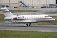 N10FE @ LAX - FedEx 1995 Canadair CL-600-2B16 (Challenger), from Memphis, TN, touching down on RWY 7R. - by Dean Heald