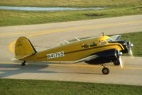 N41759 @ DPA - Taxiing by the control tower, this is UC-78B 43-31869, at the time owned by Rich Peterson and his dad at DuPage Airport - by Glenn E. Chatfield