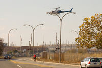 N341HP - A CHP helicopter hovers over a possible suspect in Oakland California - by Chris Humphrey