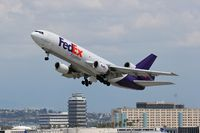 N562FE @ LAX - FedEx N562FE (FLT FDX3019) climbing out from RWY 25L enroute to Chicago Ohare Int'l (KORD), Illinois. - by Dean Heald