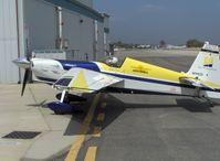 N111CD @ SZP - 1999 Zivco EDGE 540, Lycoming AEIO-540 330 Hp, taxi to hangar, note visored helmet - by Doug Robertson