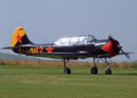 LY-AMU @ EGLS - Yakovlev Yak-52 (G-BWYK) - by Les Rickman