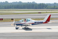 N128B @ PDK - Taxing to Epps Air Service - by Michael Martin