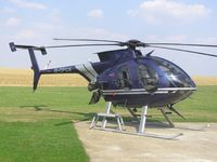 G-OPCS @ EGBK - MD500 sitting in the sun outside Skytech at Sywell - by Simon Palmer