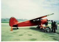 N17154 @ CMA - 1941 Stinson SR-9B RELIANT, Lycoming R680-6B6-D6 245 Hp, then owner seated, young lady pilot standing, in straw hats-circa 1994-5. Ex-Joe Ware aircraft. - by Doug Robertson