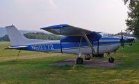 N50772 @ N05 - 1971-vintage Skyhawk takes refuge under a tarp under the hot evening sun. - by Daniel L. Berek