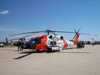 6004 @ KOSH - HH60J Coast Guard - by Mark Pasqualino