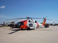 6004 @ KOSH - HH60J Coast Guard - by Mark Pasqualino
