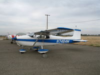 N7464M @ MER - Straight Tail 1959 Cessna 175 in lousy weather @ Castle AFB, CA