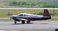 N1141K @ PDK - Landing Runway 2L - by Michael Martin