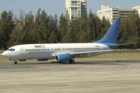 N906MA @ SJU - Miami Air Boeing 737-800 in basic Excel Airways colros