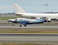 N715TL @ ANC - taking off Rwy 24L - by Kai Vollmer