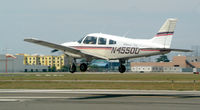N4550D @ FRG - Cherokee about to touch down RWY 19.