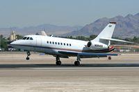 N284QS @ LAS - 2002 Dassault Falcon 2000 N284QS making a nice landing on RWY 25L. - by Dean Heald