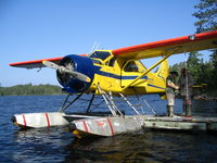 CF-IPL - Atikokan Aero's  DHC-2 at Canadian Customs on Saganaga Lake, Ontario - by Laura Marxen
