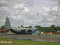 5142 @ SYCJ - C-130 on ramp at Georgetown Guyana - by John J. Boling