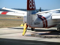 N438DF @ STS - Ground crewman hooks up retardent hose to CDF S-2T Tanker #85 at Sonoma County Airport, CA air attack base - by Steve Nation