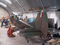 9H-ACB - Cessna 305 L-19E on rebuild at Ta'Qali Malta - by Ian Woodcock