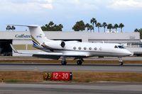 N77WL @ LGB - 1990 Gulfstream G-IV on RWY 12 after arrival from John Wayne Airport Orange County (KSNA). - by Dean Heald