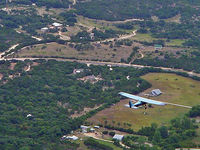 N1115R - flying over hillcountry - by Phil