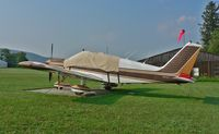 N9416J @ N05 - Faded but well cared-for 1966 Chrokee Archer takes refuge from the summer sun. - by Daniel L. Berek