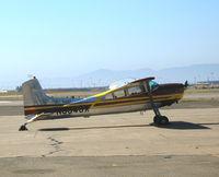 N9943X @ OAK - 1961 Cessna 185 visiting from Truckee, CA @ Oakland International Airport, CA