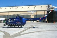 HB-ZHS @ OAK - Swiss-registered Red Bull MBB BO-105S CBS-4 photo ship for Fleet Week Red Bull air race @ Oakland International Airport, CA - by Steve Nation