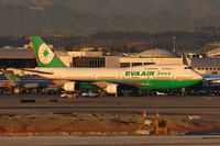 B-16461 @ LAX - EVA Air B-16461 (FLT EVA11) taxiing out of the alley at the TBIT. - by Dean Heald