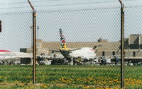 G-BNLO @ DTW - In Ndebele Emily World tail colors back in 2000