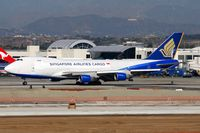 9V-SFH @ LAX - Singapore Airlines Cargo 9V-SFH (FLT SQC7966), still in hybrid colors, rolling out after arrival on RWY 25R from Ted Stevens Anchorage Int'l (PANC). - by Dean Heald