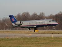 N919SW @ AZO - United Express CRJ-200