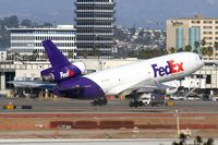 N388FE @ LAX - FedEx N388FE (FLT 3019) departing RWY 7L enroute to Chicago O'Hare Int'l (KORD). - by Dean Heald