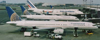 N14107 @ EWR - A Continental 757-224 joins other interesting aircraft at Newark's Terminal C in 1999. - by Daniel L. Berek