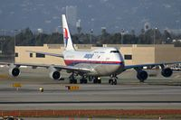 9M-MPH @ LAX - Malaysia Airlines 9M-MPH taxiing through the alley after arrival on the north complex. - by Dean Heald
