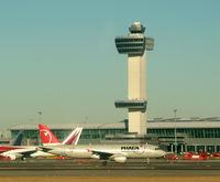 N304US @ JFK - Here we go... Tower and Terminal 4 IAT behind