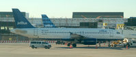 N523JB @ JFK - Born to be Blue at the gate.