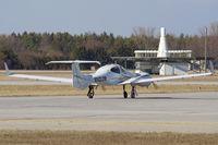 N142JW @ YXU - Taxiing on alpha for departure. - by topgun3