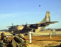 54-0700 @ POB - C-123K passing us troops waiting for loading into C-130 - by Glenn E. Chatfield