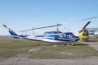 C-FBUC @ CYYC - Eagle Helicopters Bell 212 - by Yakfreak - VAP