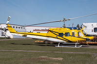 C-GEEC @ CYYC - Eagle Helicopters Bell 212 - by Yakfreak - VAP