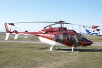 C-GMBC @ CYYC - Eagle Helicopters Bell 407 - by Yakfreak - VAP
