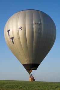 OE-KZT - A hot air baloon landing in my neighbour village.
