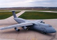 66-8306 @ CID - C-5A at the base of the control tower - by Glenn E. Chatfield