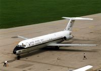 159119 @ CID - C-9B parking at the base of the control tower - by Glenn E. Chatfield