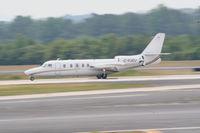 C-FJOJ @ PDK - Landing Runway 2R - by Michael Martin