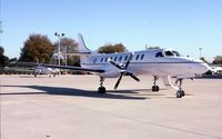91-0572 @ DPA - C-26B on the Planemasters FBO ramp - by Glenn E. Chatfield