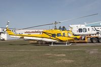 C-GEEC @ YYC - Eagle Copters Bell 212 - by Andy Graf-VAP