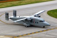 94-0311 @ CID - C-23B Sherpa taxiing past the control tower - by Glenn E. Chatfield