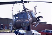 66-15185 @ ALO - UH-1M mounted on a post at the Army National Guard armory - by Glenn E. Chatfield