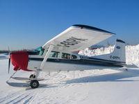 C-GSPK @ CYMM - Cessna 185 on ski's - by Ken Shearer